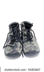 a pair of dirty black leather boots isolated on a white background