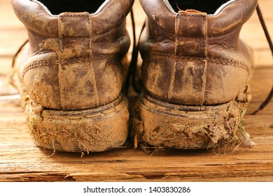Pair of dirty brown walking boots