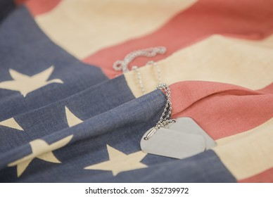 Pair of dog tags blank on american flag