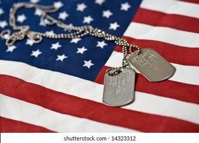 Pair of dog tags on american flag