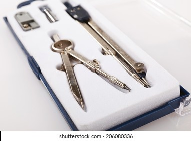Pair of drawing compasses set on a white background