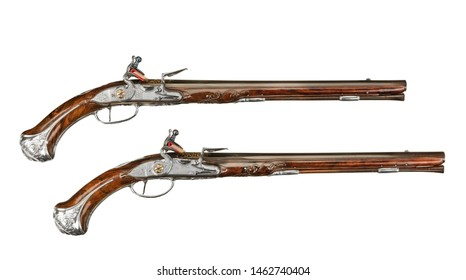 Pair early flintlock pistols possibly dueling isolated on white
