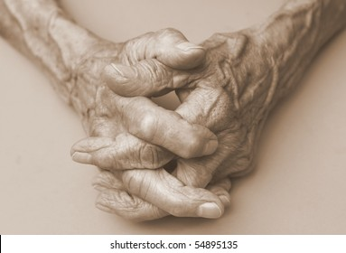 pair of elderly wrinkled hands in prayer