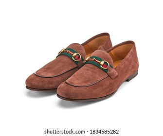 Pair of elegant men's summer shoes made of brown suede with a thin leather sole, decorated with a metal buckle. Light and practical shoes for everyday wear.