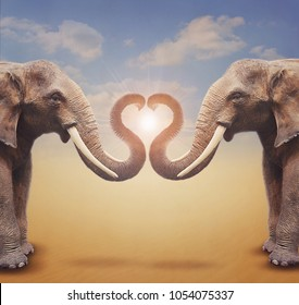 A pair of elephants arrange trumpets in the shape of a heart.  Concept for greeting card, poster, cover, and more