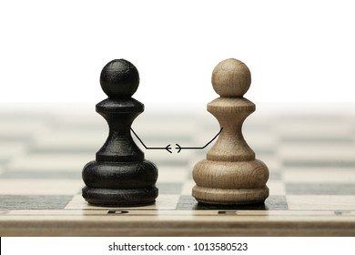 A pair of enemies reconciles and shakes hands at a meeting. Made from chess pawns