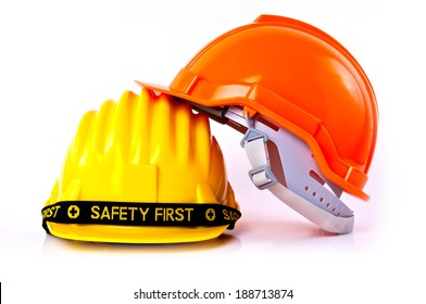 Pair of Engineer Worker Helmet two Orange and Yellow with SAFETY FIRST tag design concept isolated on white background.