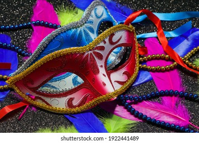 Pair Of Face Masks With Feathers And Beads