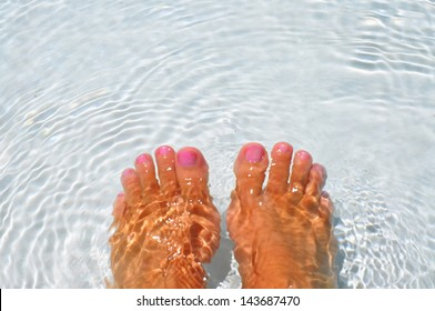 pair of feet soaking in water, room for your text