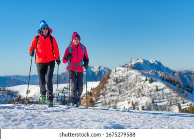 A pair of female friends during a snow hike