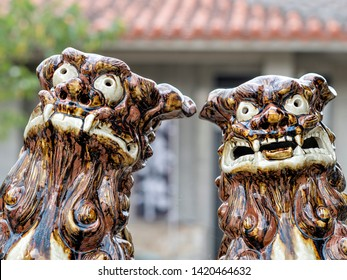 A pair of fierce looking male and female Lion Dogs guarding from evil spirits
