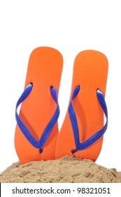 a pair of flip-flops on the sand on a white background