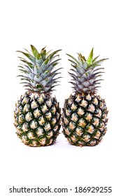 Pair of Fresh Green Pineapple Isolated on white background.