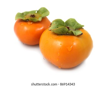 Pair of fresh Japanese Persimmons on white background