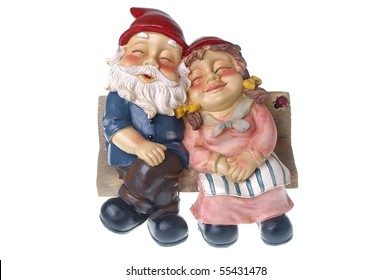 pair of garden gnomes in love together on chair