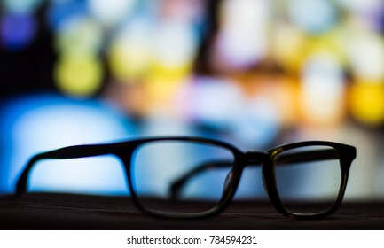A pair of glasses against the colorful background