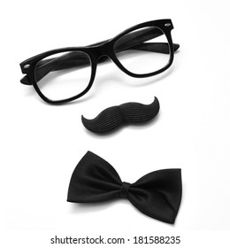 a pair of glasses, a mustache and a bowtie on a white background depicting a gentleman or a hipster guy