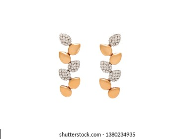 Pair of golden diamond earrings isolated on white background. Golden earrings with diamonds, luxury jewelry