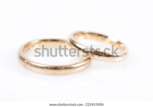 Pair of golden rings isolated on white background