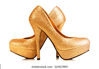 A pair of golden shoe isolated on white. with Clipping path.