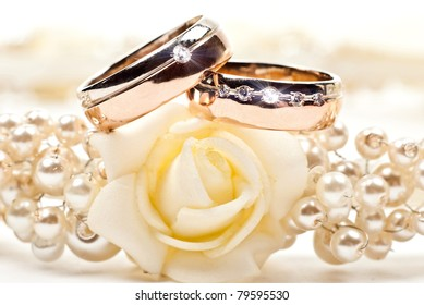 Pair of golden wedding rings. Isolated on white