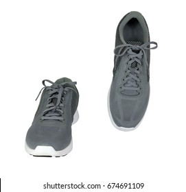 Pair gray sneakers, front and top view on white background