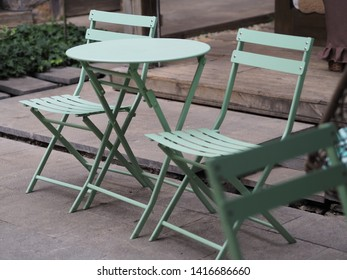 Pair of green chair in the garden.