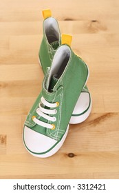 pair of green sneakers for children on the floor