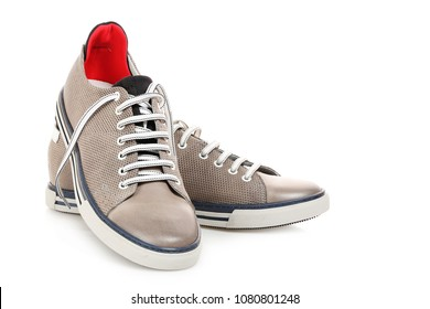pair of grey leather sneakers isolated on white