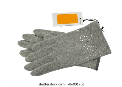 Pair of grey woolen gloves with a blank white-orange price tag beside it, on white background