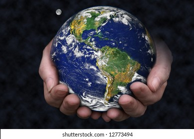 A pair of hands holding the Earth with the moon in the background. Blue Marble picture courtesy of NASA, see http://visibleearth.nasa.gov/useterms.php for terms of use