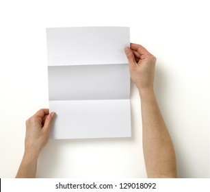 pair of hands holding folded blank A4 copy space  letter with clipping path
