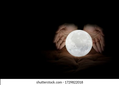 A pair of hands surrounding the moon, as if the intention is to protect the moon, or bringing down the moon to someone, very romantic.