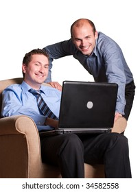 A pair of happy young men with a laptop