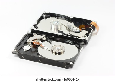 pair of  hard disk compair between  sata harddisk in front  and ide harddisk back one  on white backgound