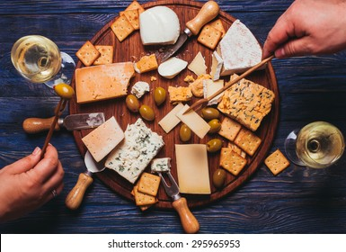 Pair have a nice evening with cheese plate and wine