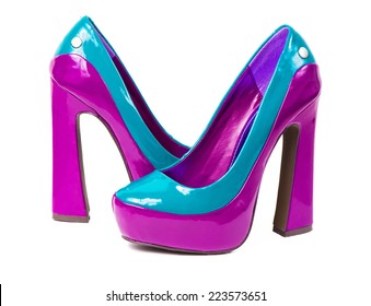 Pair of high heel shoes on white