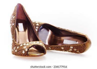 Pair of high heels with diamonds and golden beads