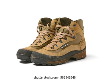 A pair of hiking boots - white background - closeup