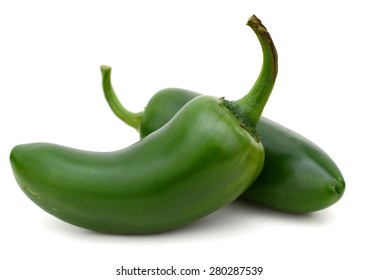 a pair of jalapeno peppers isolated on white