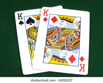 Pair of kings on a card table