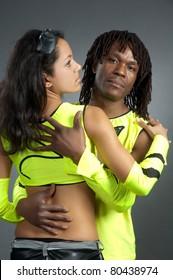 Pair lad and girl in bright dance suit in studio