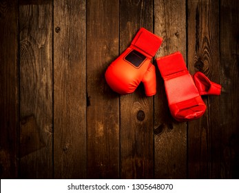 Pair of leather karate gloves lying on the wooden table