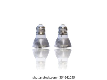 Pair of LED light bulbs isolated on white with reflection