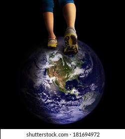 a pair of legs walking on the earth (Elements of this image furnished by NASA)