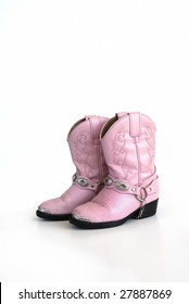 Pair of little girls pink leather cowgirl boots on white background.