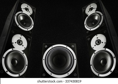 Pair of loudspeakers and subwoofer on abstract space background