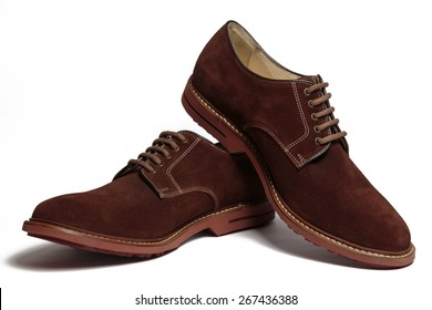 Pair of male classic brown suede shoes isolated on the white background