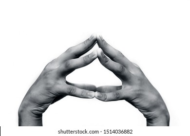 Pair of male hands isolated on white joined and doing Hakini Mudra. Horizontal shot.