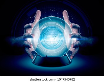 A pair of male hands surrounding a crystal ball conjuring up a dash crytocurrency hologram on an isolated dark studio background